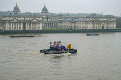 Tug on the Thames, passing the Royal Naval College, Greenwich Un. Afternoon, winter& x27;s shot on a misty afternoon of this tug travelling up the River Thames stock photography