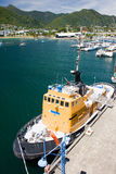 Tug tied to the pier. Tug vessel in port of Picton, New Zealand royalty free stock image