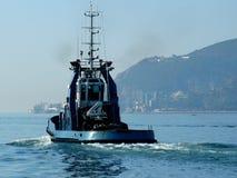 Tug to Sea. Tug sailing out to sea. Setubal, Portugal Stock Image