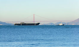 Tug towing a barge into the San Francisco Bay Stock Photography