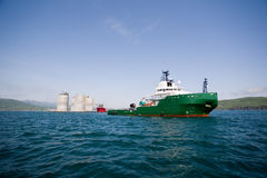 Tug towing offshore oil platform Stock Photo