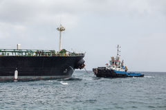 Tug Towing Tanker Stock Photography