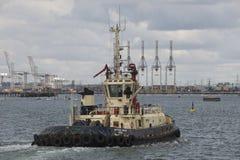 Tug underway Port of Southampton UK Royalty Free Stock Images
