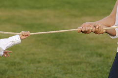 Tug of war. Close up on hands. duel and challenge concept royalty free stock images