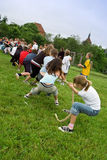 Tug of war. School playground, boys and girls are playing tug of war stock images