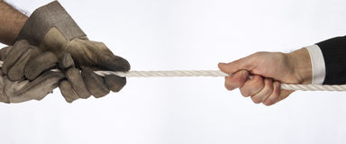 Tug of war. Hands that do tug of war Stock Photos