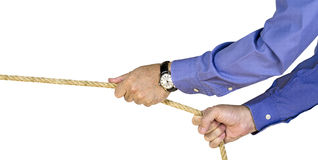 Tug of War. A businessman pulling a rope Royalty Free Stock Photos