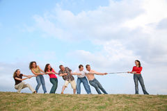 Tug of War. On woman against a group in tug of war competition royalty free stock photo