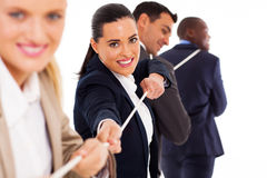 Tug of war. Group of business people playing tug of war royalty free stock photography