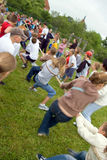 Tug of war. School playground, boys and girls are playing tug of war. On the first day of spring, a Sports Day is organised in Polish schools. Time for outdoor royalty free stock photography