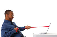 Tug of war. Business man pulling a rope through his laptop Stock Photography