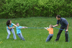 Tug-of-war. Family leisure activity - tug-of-war stock images
