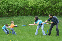 Tug-of-war. Family leisure activity - tug-of-war royalty free stock image