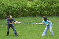 Tug-of-war. Family leisure activity - tug-of-war royalty free stock photos