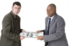 Tug of War. With over sized money royalty free stock photography