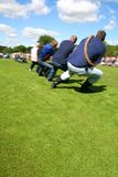 Tug of War. Another Team another Giant of a Man anchor's as the Blue team show gritty determination to pull to next round. Plenty of room for Text if needed Royalty Free Stock Image