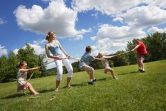 Tug Of War Between Dad And Mom With Kids Stock Image