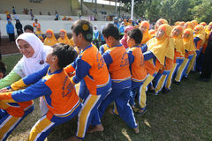 Tug of war. Elementary school students follow the tug of war in the city of Solo, Central Java, Indonesia stock photos
