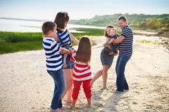 Tug of war - family playing on the beach Royalty Free Stock Images