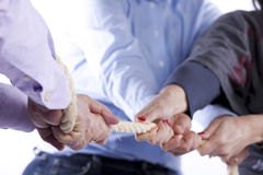 Tug-of-war hands Stock Images
