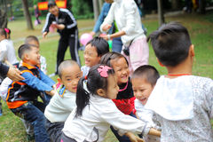 Tug of war. Liuzhou,China:A group of children play tug of war in a park stock photography