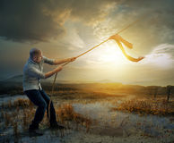 Tug of war. A man plays tug of war with heaven royalty free stock photography
