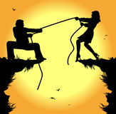 Tug of war between man and woman Royalty Free Stock Photography
