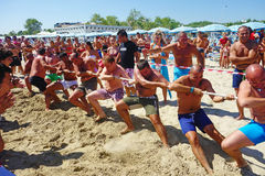 Tug War Men Beach Intense Competition Team Stock Photo