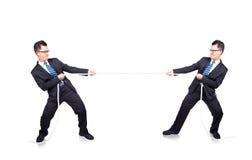 Tug of war with myself. Business man playing tug of war with himself Stock Image
