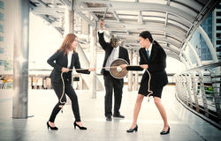 Tug of War office business workers businesswomen battle Royalty Free Stock Images