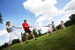 Tug Of War Between Parents And Kids. A Tug Of War Between Parents And Kids Royalty Free Stock Images