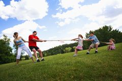 Tug Of War Between Parents And Kids. A Tug Of War Between Parents And Kids Royalty Free Stock Photos
