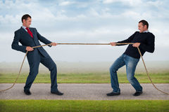 Tug of war between the same man Royalty Free Stock Photo