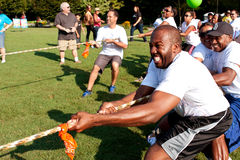 Tug-Of-War Teams Pull Rope In Summer Fundraising Event Stock Images