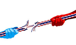 Tug of war. Thai Two color pulling rope, tug of war, in business competitive concept Royalty Free Stock Images