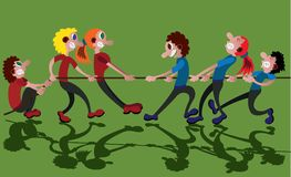 Tug of War. Two opposing teams compete in a tug of war Stock Photo