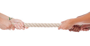 Tug war. Two sides doing a tug war. All on white background royalty free stock photo
