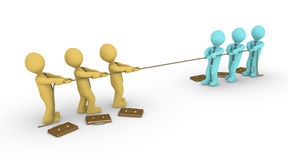 Tug of war between two teams. Two different colored business teams engage in a tug of war Royalty Free Stock Images
