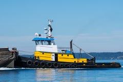Tug Wasp pushing a barge royalty free stock image