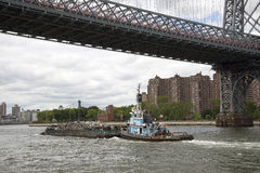 Tug working with barge on East River New York USA Royalty Free Stock Photo