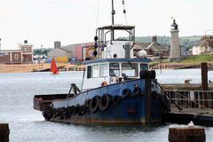 Tugboat. Moored at dock Stock Image