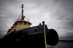 Tugboat. A dramatic view of a tugboat tied up in Halifax harbour Royalty Free Stock Images