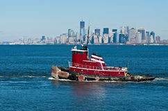 Tugboat. On the Hudson River against the backdrop of Manhattan Stock Images