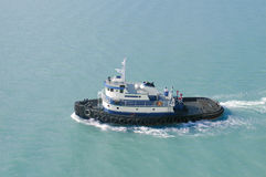 Tugboat. Traveling through water, taken from a cruise ship in Alaska Stock Image