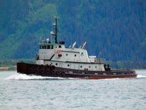 A tugboat arriving at seward's harbor Royalty Free Stock Images