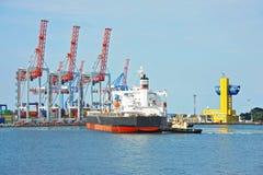 Tugboat assisting bulk cargo ship Royalty Free Stock Photography