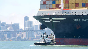 Tugboat assisting MSC KATRINA to maneuver through the San Francisco Bay Royalty Free Stock Photography