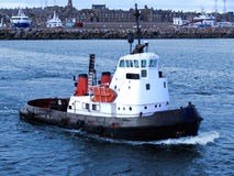 Tugboat B2. Harbour tugboat underway in harbour area Royalty Free Stock Image