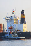 Tugboat beside big container ship in vessel river line. Tugboat beside  big container ship in vessel river line Stock Image