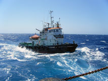 Tugboat in a blue sea Stock Photo